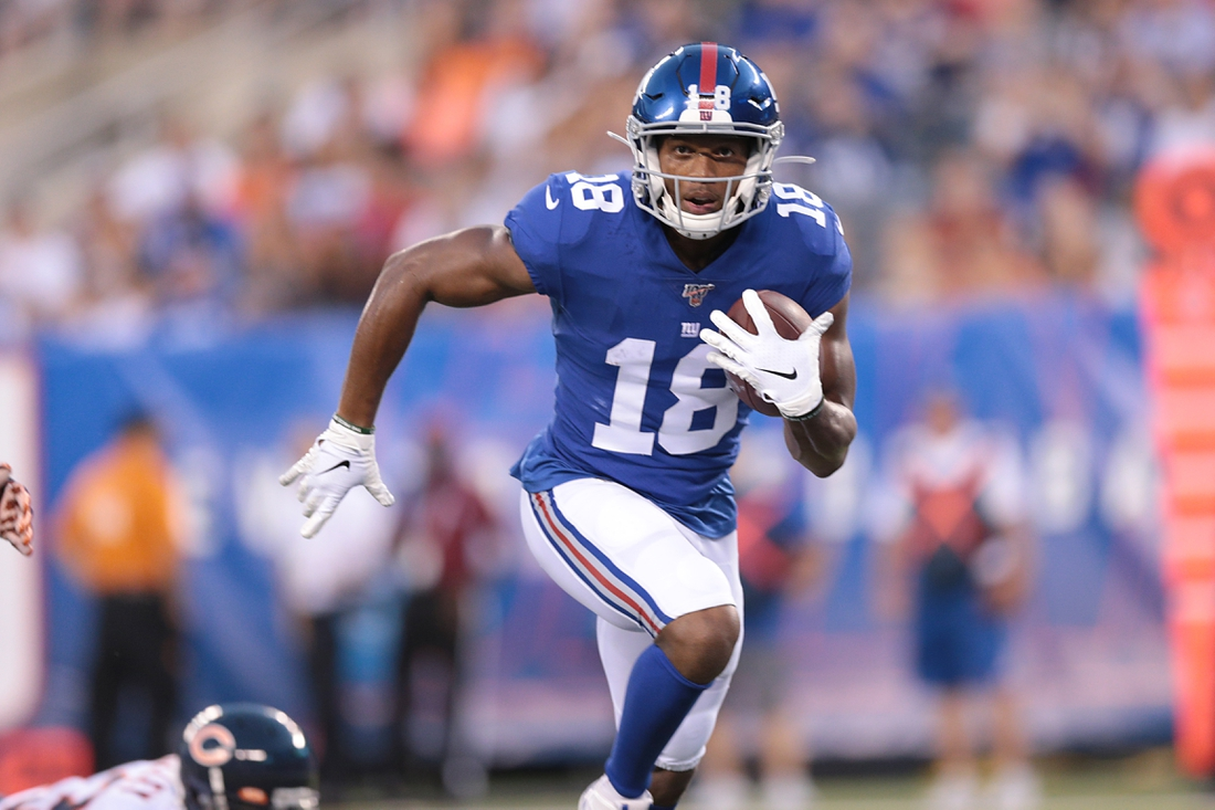 Aug 16, 2019; East Rutherford, NJ, USA; New York Giants wide receiver Bennie Fowler (18) catches a pass and runs for a touchdown during the first half against the Chicago Bears at MetLife Stadium. Mandatory Credit: Vincent Carchietta-USA TODAY Sports
