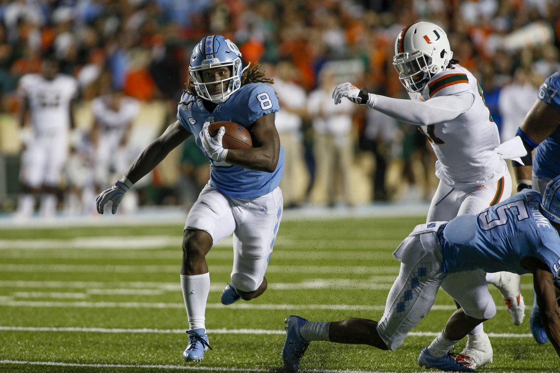 Sep 7, 2019; Chapel Hill, NC, USA; North Carolina Tar Heels running back Michael Carter (8) rushes for a first down against the Miami Hurricanes during a game-winning drive in the fourth quarter at Kenan Memorial Stadium. The North Carolina Tar Heels won 28-25. Mandatory Credit: Nell Redmond-USA TODAY Sports