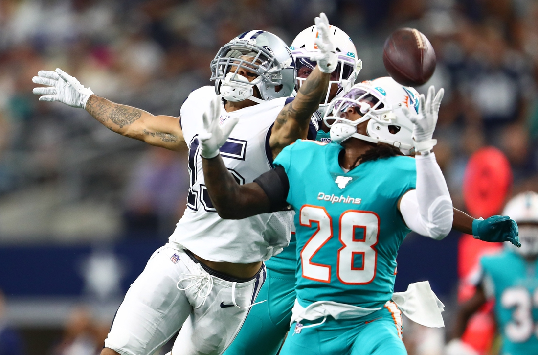 Sep 22, 2019; Arlington, TX, USA; Dallas Cowboys receiver Devin Smith (15) can not make the catch in the second quarter against Miami Dolphins safety Bobby McCain (28) at AT&T Stadium. Mandatory Credit: Matthew Emmons-USA TODAY Sports