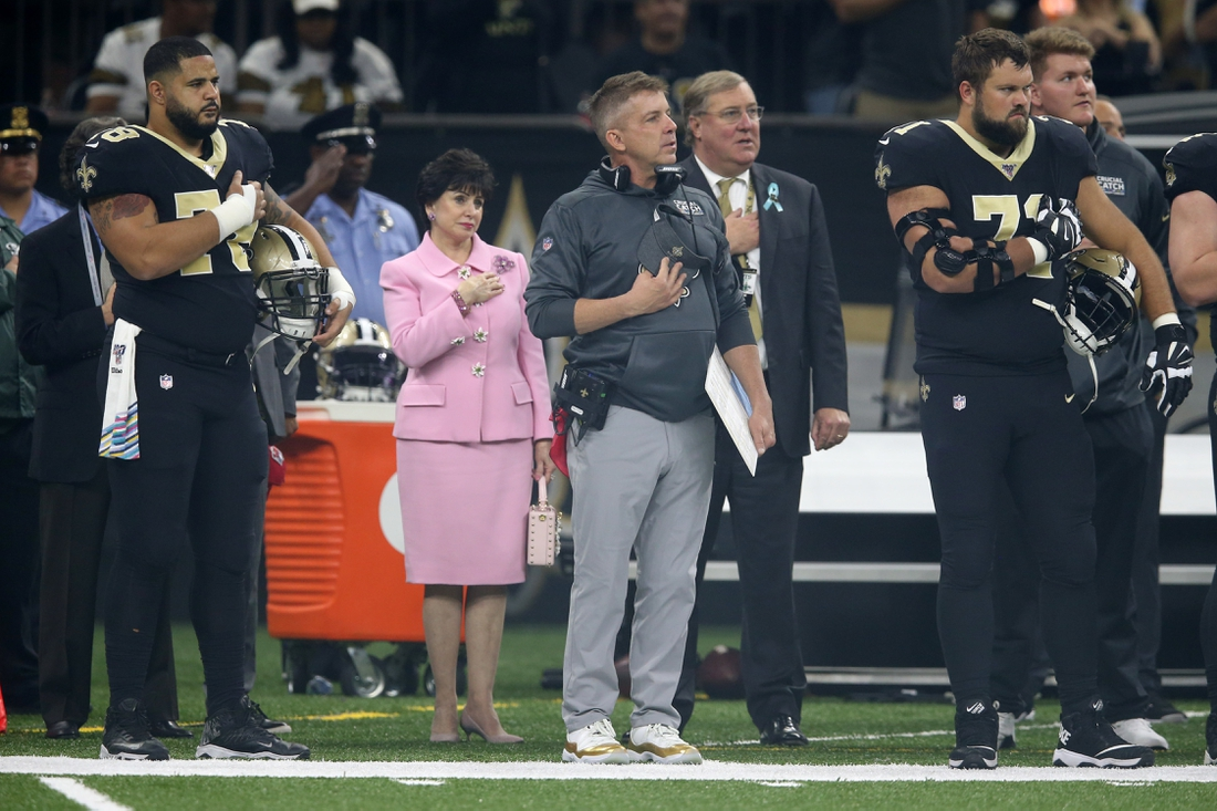 Oct 6, 2019; New Orleans, LA, USA; New Orleans Saints head coach Sean Payton stands during the National Anthem with team owner Gayle Benson (middle left) and team president Dennis Lauscha (middle right) before a game against the Tampa Bay Buccaneers at the Mercedes-Benz Superdome. Mandatory Credit: Chuck Cook-USA TODAY Sports