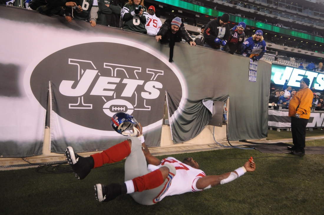 Giants' Brandon Jacobs pretends to crash while flying into the locker room after their win over the Jets at MetLife Stadium.  0000jacobs24164e56 00006