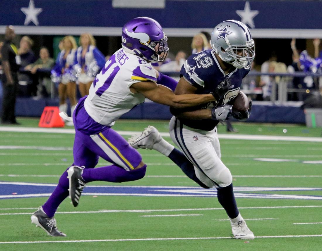 Dallas Cowboys' Amari Cooper is tackled by Minnesota Vikings' Mike Hughes Sunday, Nov. 10, 2019, at AT&T Stadium in Arlington. The Vikings defeated the Cowboys 28-24.  Nfl Dallas Cowboys Minnesota Vikings
