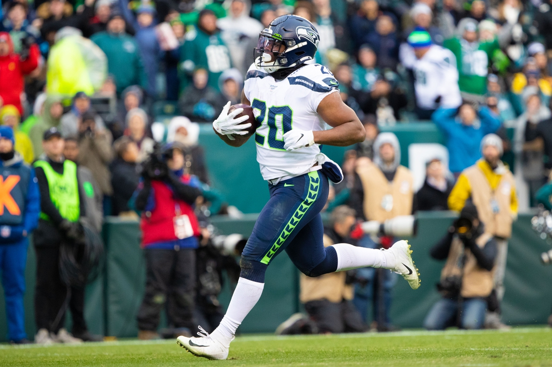 Nov 24, 2019; Philadelphia, PA, USA; Seattle Seahawks running back Rashaad Penny (20) runs for a touchdown against the Philadelphia Eagles during the fourth quarter at Lincoln Financial Field. Mandatory Credit: Bill Streicher-USA TODAY Sports