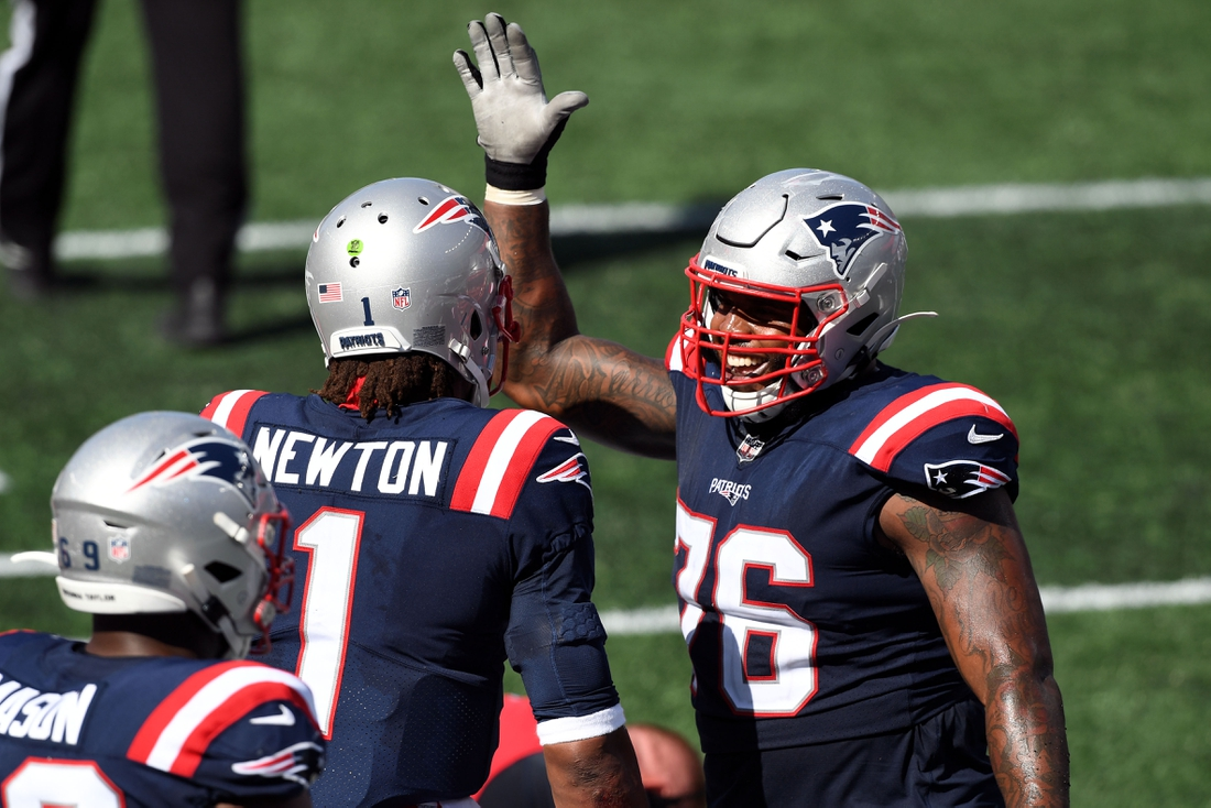 Sep 13, 2020; Foxborough, Massachusetts, USA; New England Patriots quarterback Cam Newton (1) celebrates with offensive tackle Isaiah Wynn (76) after scoring a touchdown against the Miami Dolphins during the third quarter at Gillette Stadium. Mandatory Credit: Brian Fluharty-USA TODAY Sports