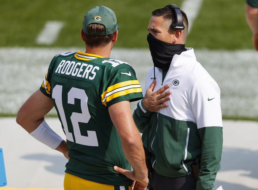 Sep 20, 2020; Green Bay, Wisconsin, USA;  Green Bay Packers quarterback Aaron Rodgers (12) talks with head coach Matt LaFleur during the third quarter of the game against the Detroit Lions at Lambeau Field. Mandatory Credit: Jeff Hanisch-USA TODAY Sports