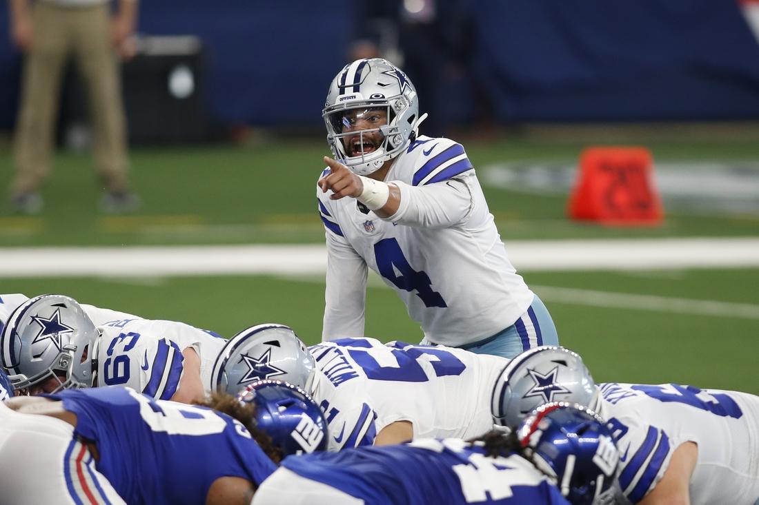 Oct 11, 2020; Arlington, Texas, USA; Dallas Cowboys quarterback Dak Prescott (4) calls a play in the second quarter against the New York Giants at AT&T Stadium. Mandatory Credit: Tim Heitman-USA TODAY Sports