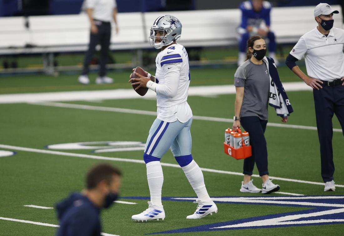 Oct 11, 2020; Arlington, Texas, USA; Dallas Cowboys quarterback Dak Prescott (4) throws a pass before the game against the New York Giants at AT&T Stadium. Mandatory Credit: Tim Heitman-USA TODAY Sports