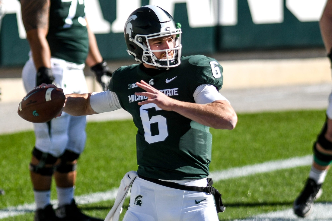 Michigan State's Theo Day throws a pass before the game against Rutgers on Saturday, Oct. 24, 2020, at Spartan Stadium in East Lansing.  201024 Msu Rutgers 054a
