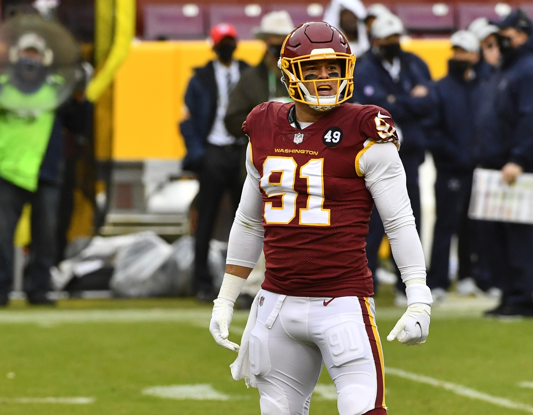 Oct 25, 2020; Landover, Maryland, USA; Washington Football Team defensive end Ryan Kerrigan (91) reacts after recording a sack against the Dallas Cowboys during the second half at FedExField. Mandatory Credit: Brad Mills-USA TODAY Sports