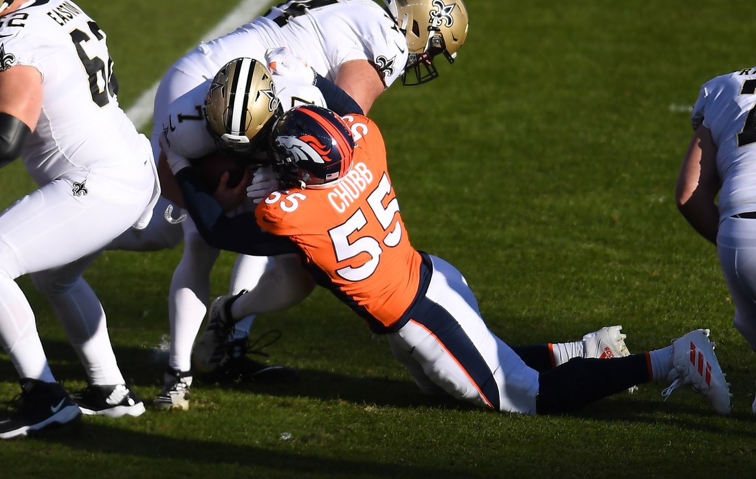 Nov 29, 2020; Denver, Colorado, USA; Denver Broncos outside linebacker Bradley Chubb (55) sacks New Orleans Saints quarterback Taysom Hill (7) in the first quarter at Empower Field at Mile High. Mandatory Credit: Ron Chenoy-USA TODAY Sports