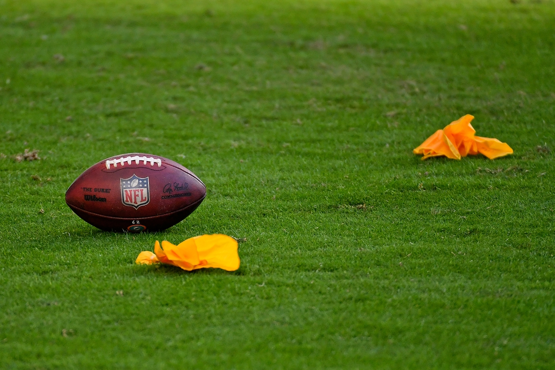 Dec 13, 2020; Miami Gardens, Florida, USA; A football and penalty flags as seen on the field during the second half between the Miami Dolphins and the Kansas City Chiefs at Hard Rock Stadium. Mandatory Credit: Jasen Vinlove-USA TODAY Sports