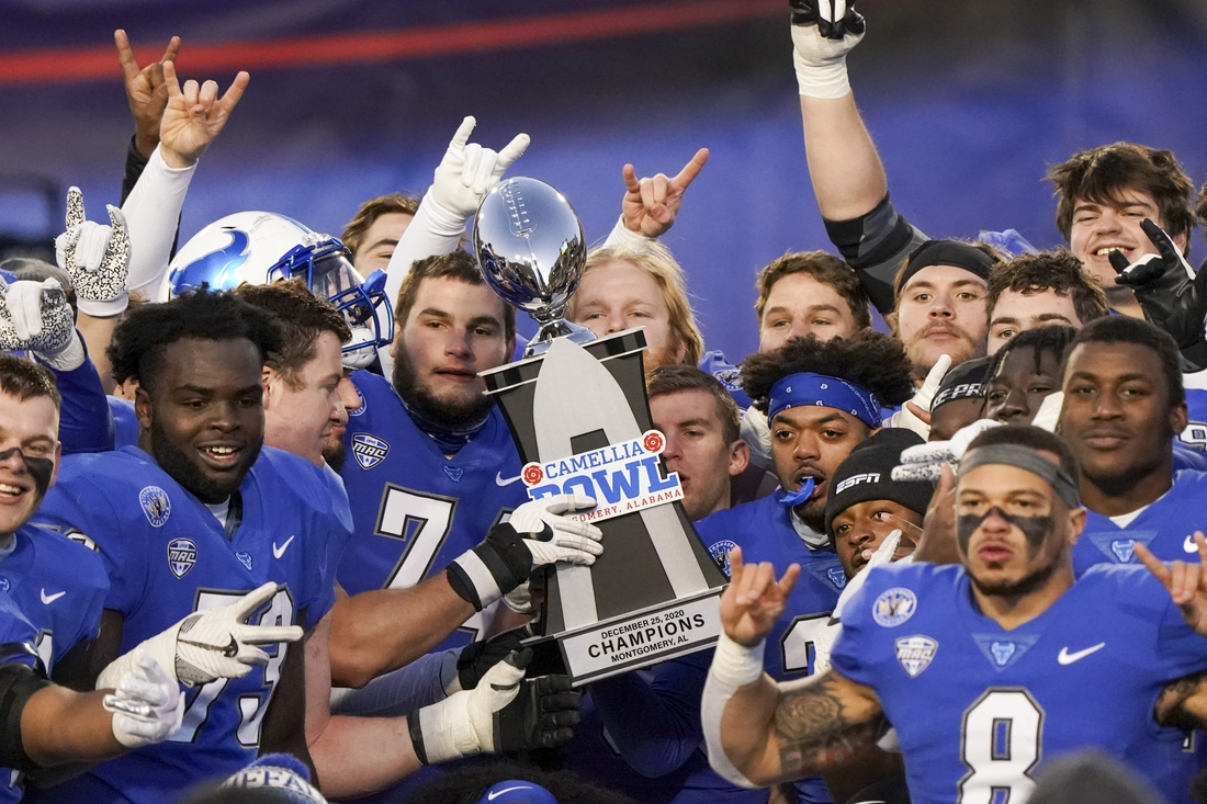 Dec 25, 2020; Montgomery, AL, USA; Buffalo Bulls hoist the trophy after winning the Camellia Bowl against Marshall Thundering Herd during the second half at Cramton Bowl Stadium. Mandatory Credit: Marvin Gentry-USA TODAY Sports