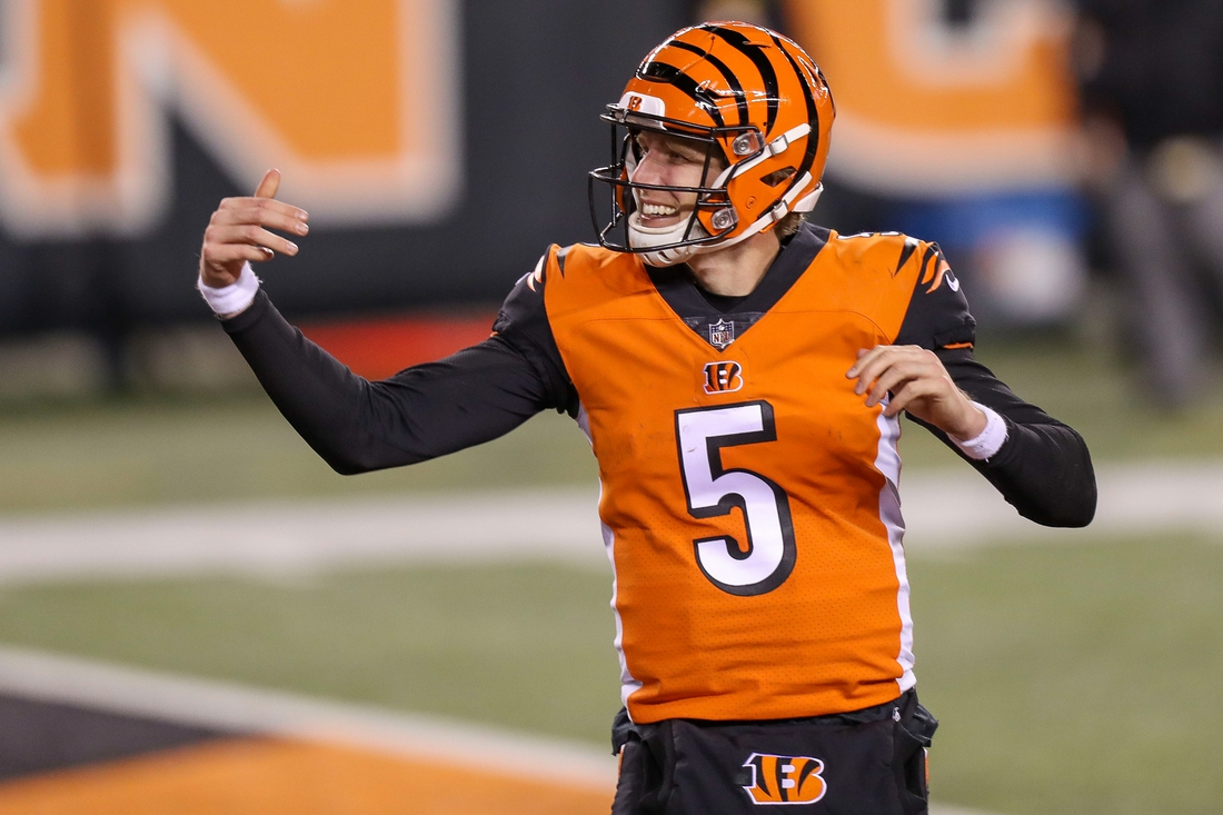 Dec 21, 2020; Cincinnati, Ohio, USA; Cincinnati Bengals quarterback Ryan Finley (5) reacts after scoring a touchdown in the second half against the Pittsburgh Steelers at Paul Brown Stadium. Mandatory Credit: Katie Stratman-USA TODAY Sports