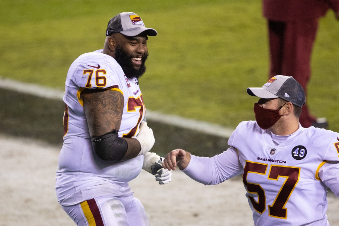 Jan 3, 2021; Philadelphia, Pennsylvania, USA; Washington Football Team offensive tackle Morgan Moses (76) and long snapper Nick Sundberg (57) celebrate after winning the NFC East championship in a game against the Philadelphia Eagles at Lincoln Financial Field. Mandatory Credit: Bill Streicher-USA TODAY Sports