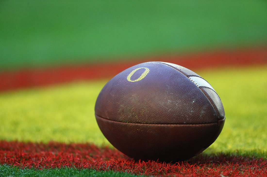 Jan 2, 2021; Glendale, AZ, USA; Detailed view of an Oregon Ducks logo on an official football on the field during the Fiesta Bowl at State Farm Stadium. Mandatory Credit: Mark J. Rebilas-USA TODAY Sports