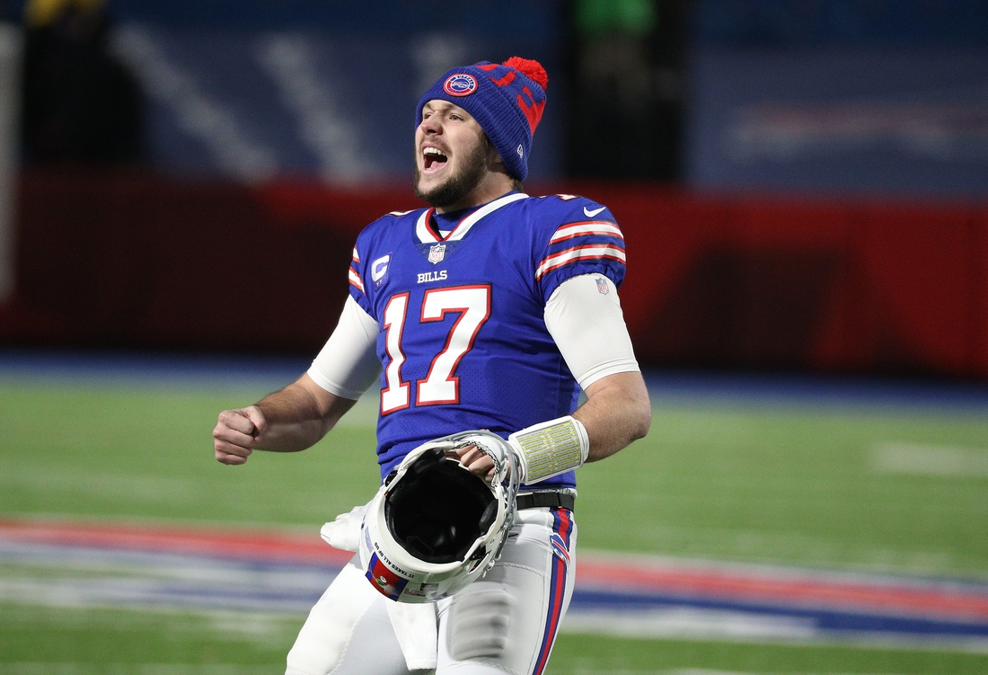 Bills quarterback Josh Allen celebrates with the crowd after beating the Ravens 17-3 in the AFC divisional playoff game.  Jg 011621 Bills 2