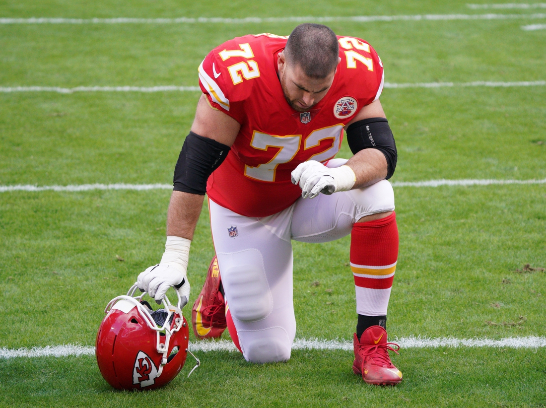 Jan 17, 2021; Kansas City, Missouri, USA; Kansas City Chiefs offensive tackle Eric Fisher (72) kneels on field before the AFC Divisional Round playoff game against the Cleveland Browns at Arrowhead Stadium. Mandatory Credit: Denny Medley-USA TODAY Sports