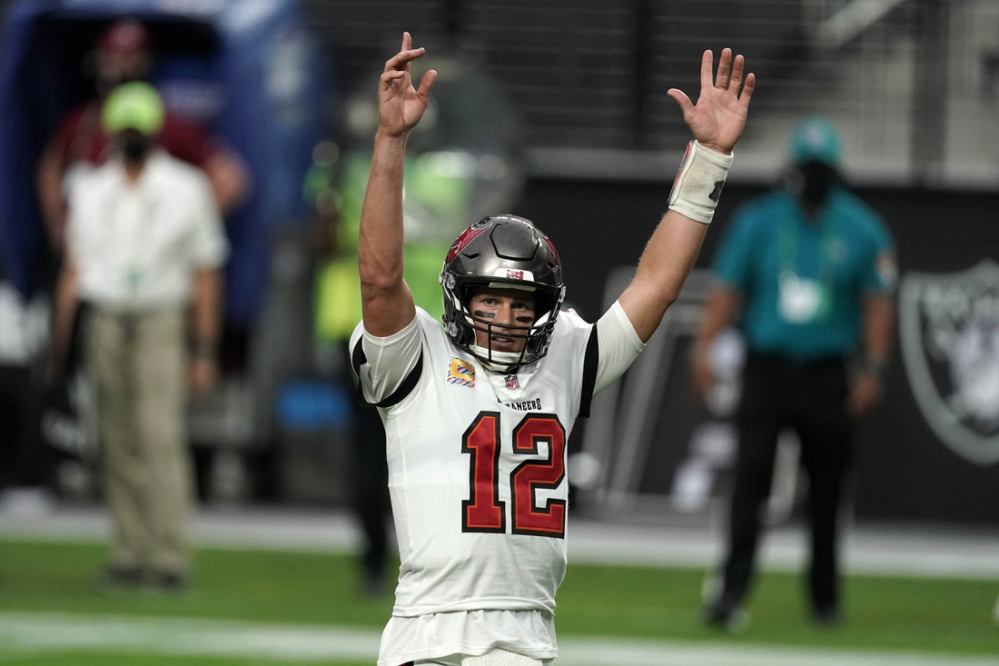 Oct 25, 2020; Paradise, Nevada, USA; Tampa Bay Buccaneers quarterback Tom Brady (12) celebrates after a touchdown in the fourth quarter against the Las Vegas Raiders at Allegiant Stadium. The Buccaneers defeated the Raiders 45-20. Mandatory Credit: Kirby Lee-USA TODAY Sports
