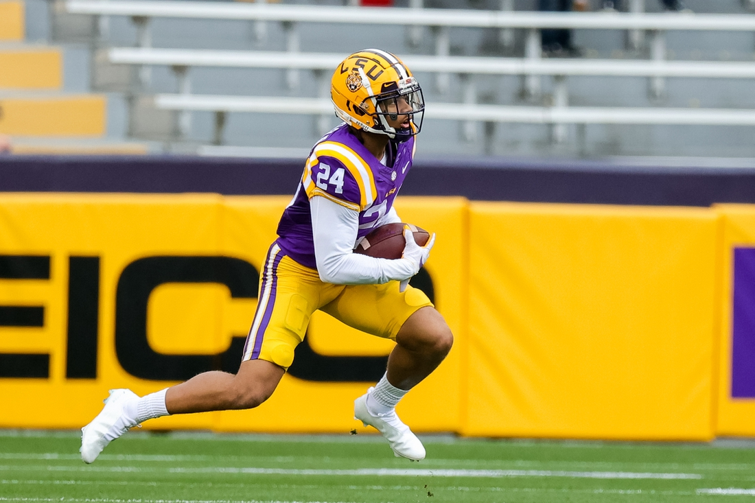 Apr 17, 2021; Baton Rouge, Louisiana, USA;  LSU Tigers cornerback Derek Stingley Jr. (24) returns a punt during the first half of the annual Purple and White spring game at Tiger Stadium. Mandatory Credit: Stephen Lew-USA TODAY Sports