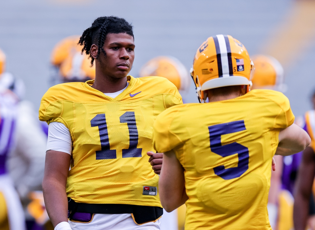 Apr 17, 2021; Baton Rouge, Louisiana, USA;  LSU Tigers quarterback TJ Finley (11) warms up with LSU Tigers quarterback Garrett Nussmeier (5) on the sidelines during the first half of the annual Purple and White spring game at Tiger Stadium. Mandatory Credit: Stephen Lew-USA TODAY Sports