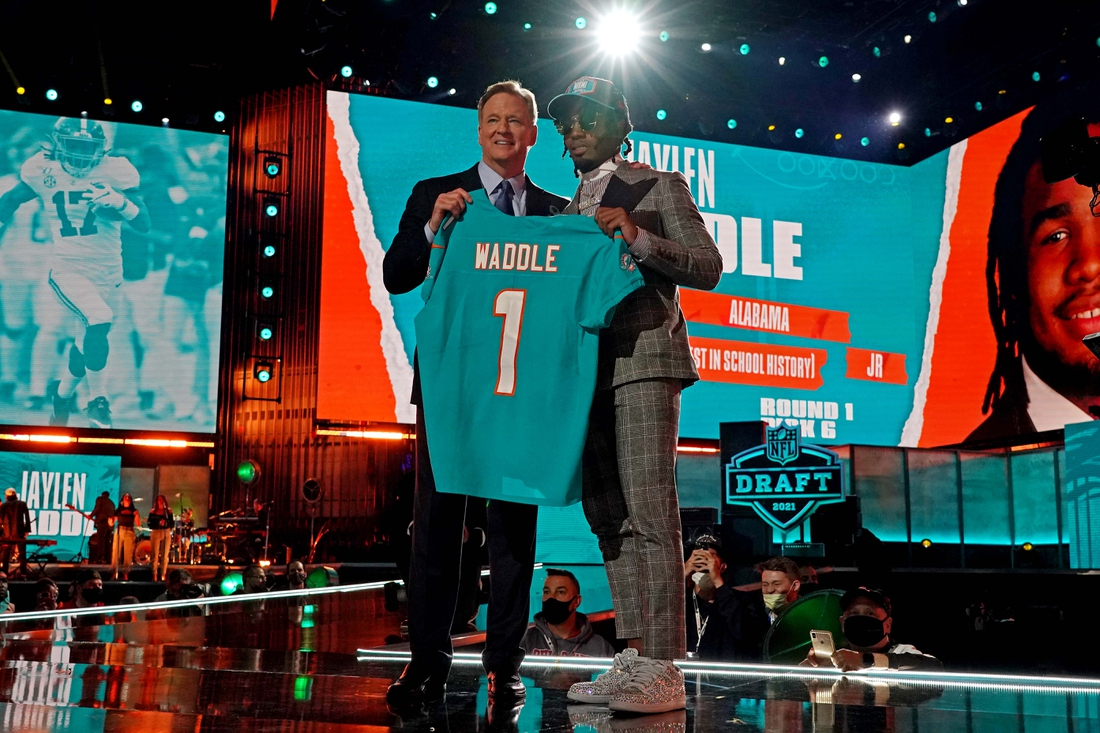 Apr 29, 2021; Cleveland, Ohio, USA; Jaylen Waddle (Alabama) with NFL commissioner Roger Goodell after being selected by Miami Dolphins as the number six overall pick in the first round of the 2021 NFL Draft at First Energy Stadium. Mandatory Credit: Kirby Lee-USA TODAY Sports