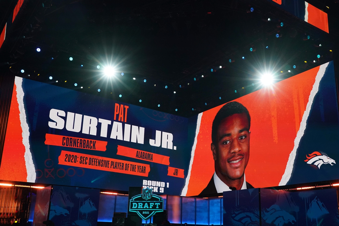 Apr 29, 2021; Cleveland, Ohio, USA; Alabama Crimson Tide corrnerback Patrick Surtain Jr. is displayed on the video board after being selected as the ninth pick by the Denver Broncos during the 2021 NFL Draft  at First Energy Stadium. Mandatory Credit: Kirby Lee-USA TODAY Sports