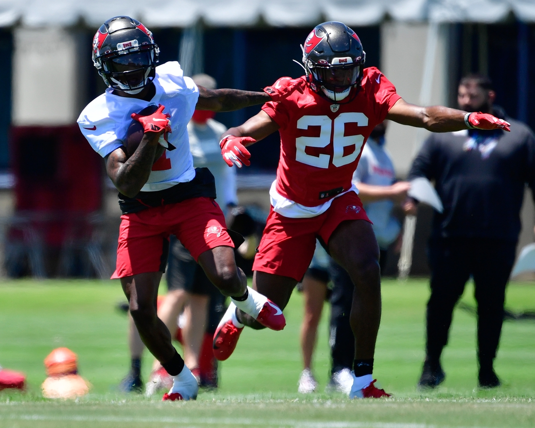 May 14, 2021; Tampa Bay, Florida, USA; Tampa Bay Buccaneers wide receiver Jaelon Darden (1) and corner back Cameron Kinley (26) practice during rookie mini-camp at AdventHealth Training Center Mandatory Credit: Douglas DeFelice-USA TODAY Sports