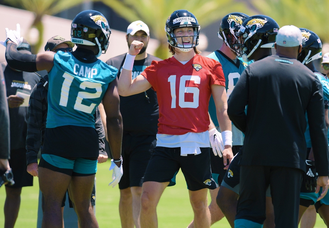 Jaguars quarterback Trevor Lawrence (16) talks with teammates during drills at rookie minicamp.  Jki 051521 Jaguarsrookiecamp 05