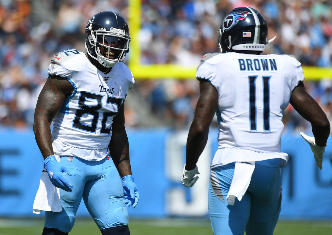 Sep 15, 2019; Nashville, TN, USA; Tennessee Titans tight end Delanie Walker (82) and Tennessee Titans wide receiver A.J. Brown (11) celebrate after a reception during the first half against the Indianapolis Colts at Nissan Stadium. Mandatory Credit: Christopher Hanewinckel-USA TODAY Sports