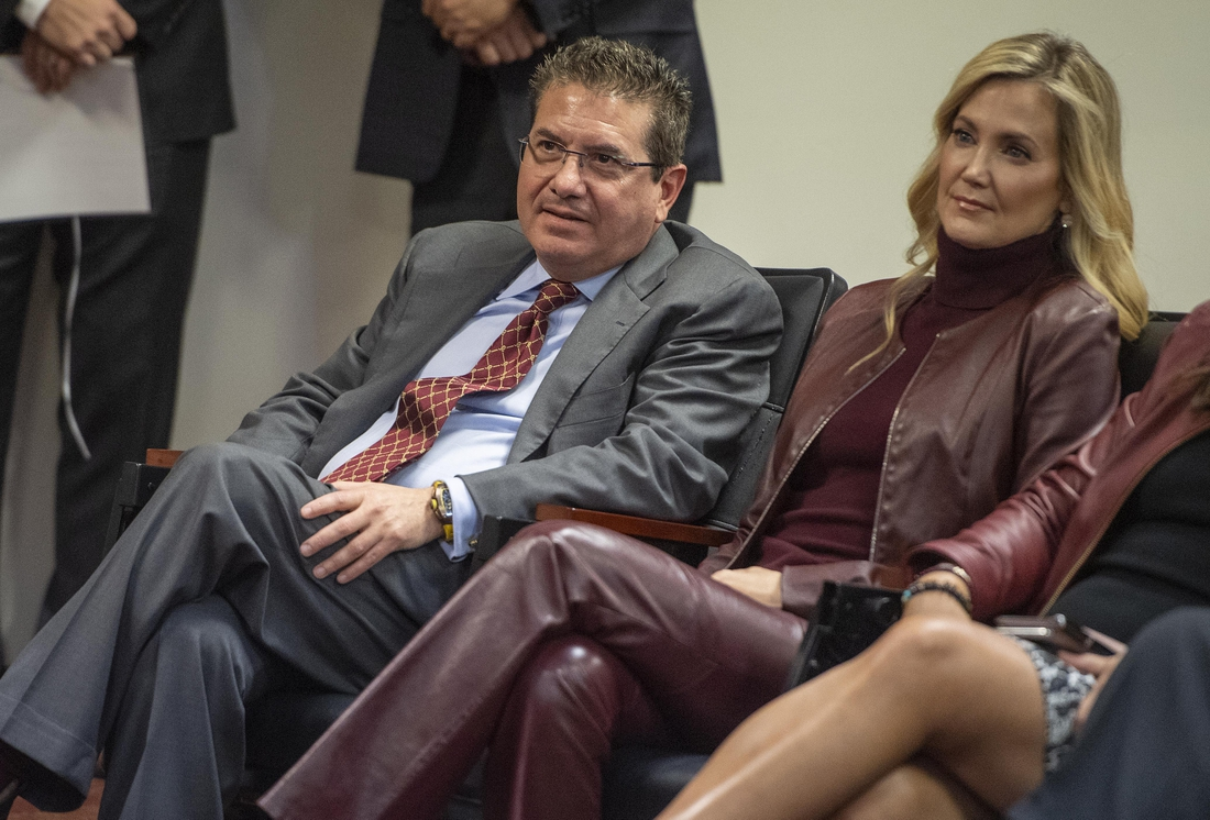 Jan 2, 2020; Ashburn, VA, USA; Washington Redskins owner Daniel Snyder and his wife Tanya look on as head coach Ron Rivera speaks during his introductory press conference at Inova Sports Performance Center. Mandatory Credit: Brad Mills-USA TODAY Sports
