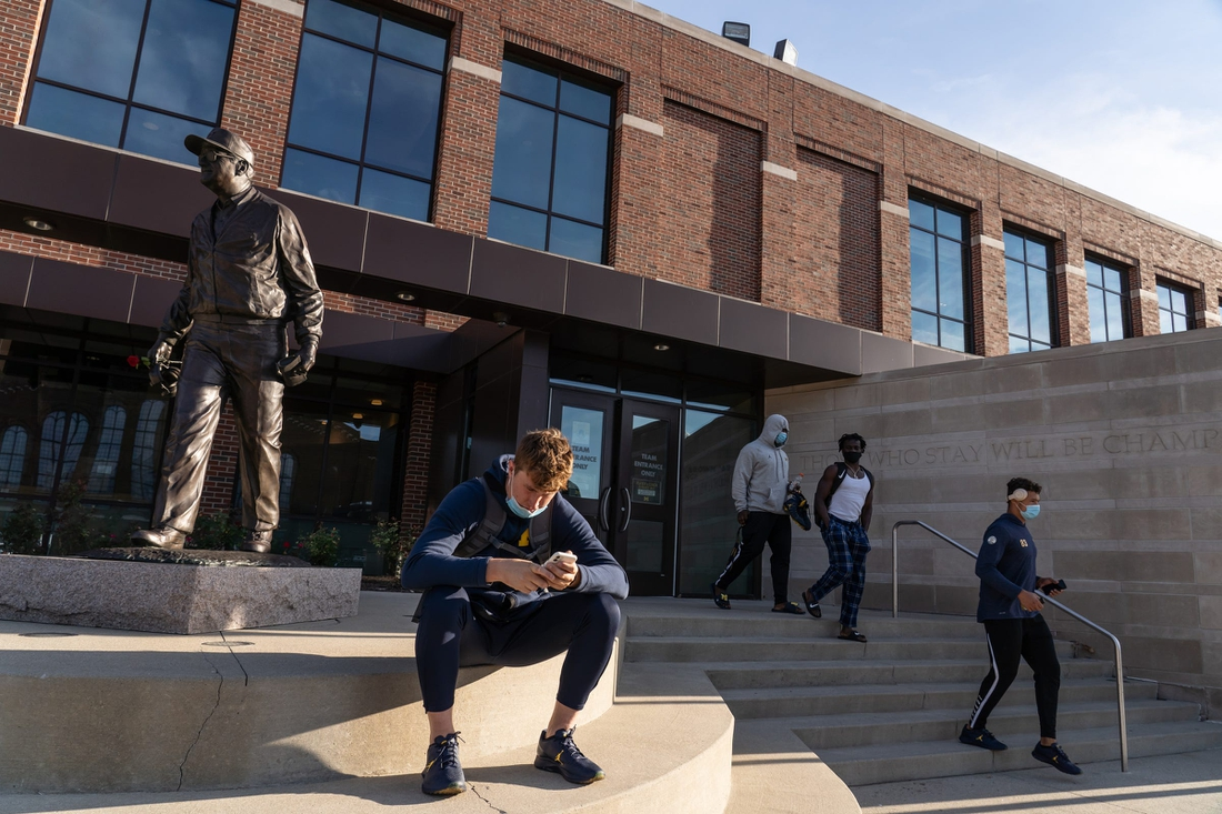 Michigan redshirt QB Max Wittwer sits outside Schembechler Hall in Ann Arbor, Tuesday, August 11, 2020.  081120 Big 10 Cancelled Rg