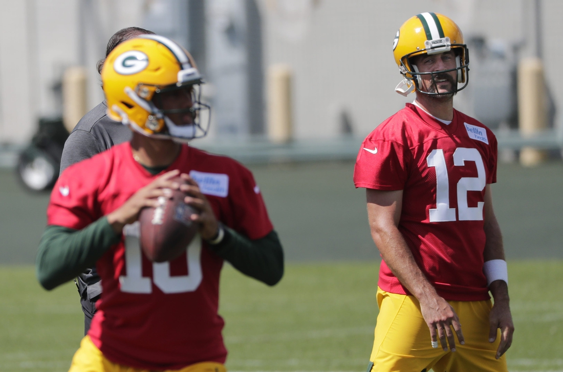 Green Bay Packers quarterback Aaron Rodgers (12) and quarterback Jordan Love (10) are shown Monday, August 17, 2020, during training camp in Green Bay, Wis.  Apc Packerstrainingcamp 0817201049