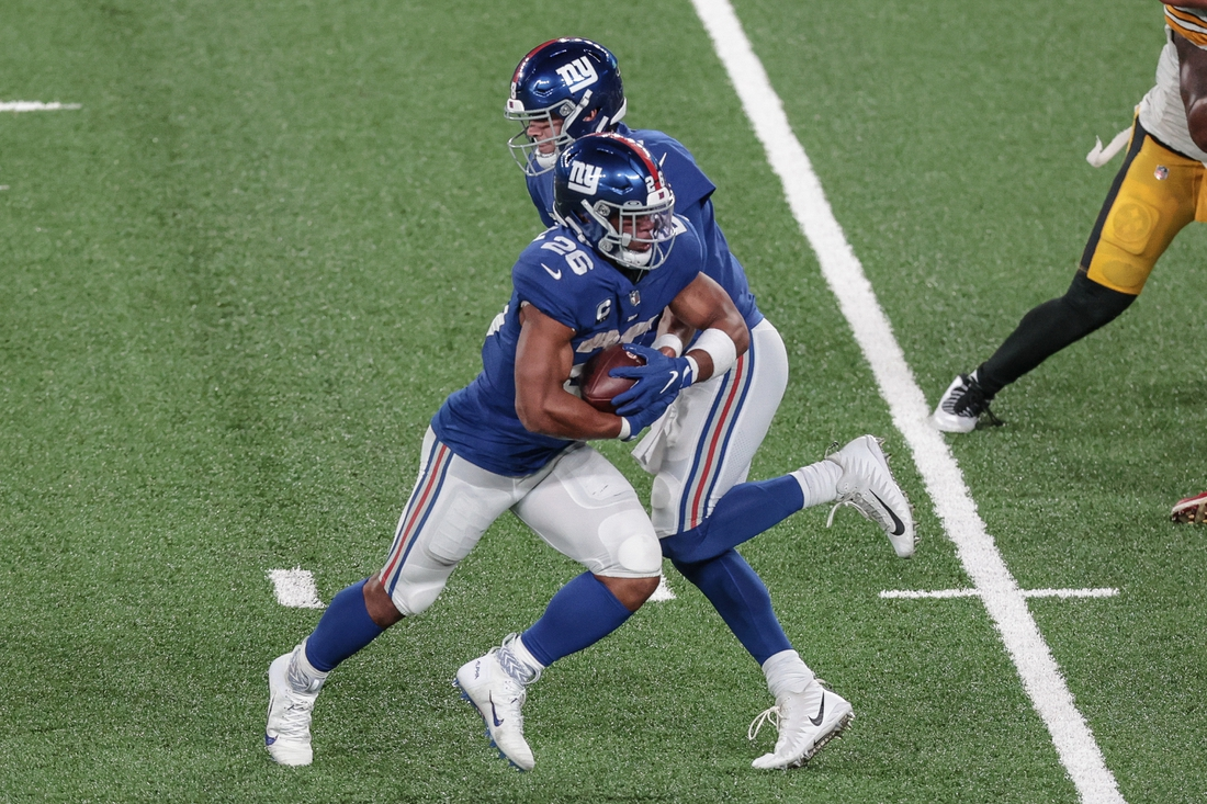 Sep 14, 2020; East Rutherford, New Jersey, USA; New York Giants quarterback Daniel Jones (8) hands off to  running back Saquon Barkley (26) during the first half against the Pittsburgh Steelers at MetLife Stadium. Mandatory Credit: Vincent Carchietta-USA TODAY Sports