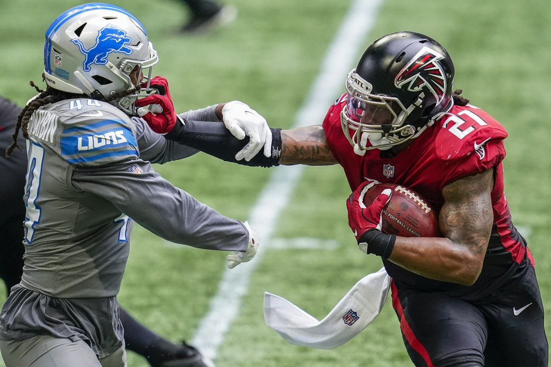 Oct 25, 2020; Atlanta, Georgia, USA; Atlanta Falcons running back Todd Gurley II (21) attempts to prevent a tackle by Detroit Lions linebacker Jalen Reeves-Maybin (44) during the second half at Mercedes-Benz Stadium. Mandatory Credit: Dale Zanine-USA TODAY Sports