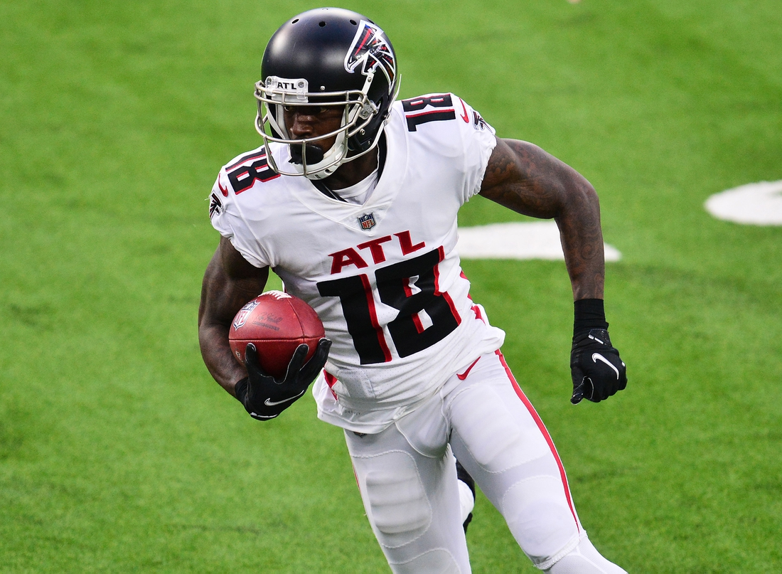 Dec 13, 2020; Inglewood, California, USA; Atlanta Falcons wide receiver Calvin Ridley (18) runs the ball against the Los Angeles Chargers during the first half at SoFi Stadium. Mandatory Credit: Gary A. Vasquez-USA TODAY Sports
