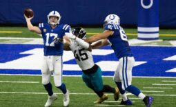 Jan 3, 2021; Indianapolis, Indiana, USA; Indianapolis Colts quarterback Philip Rivers (17) passes the ball while Jacksonville Jaguars defensive end K'Lavon Chaisson (45) defends in the first half at Lucas Oil Stadium. Mandatory Credit: Trevor Ruszkowski-USA TODAY Sports