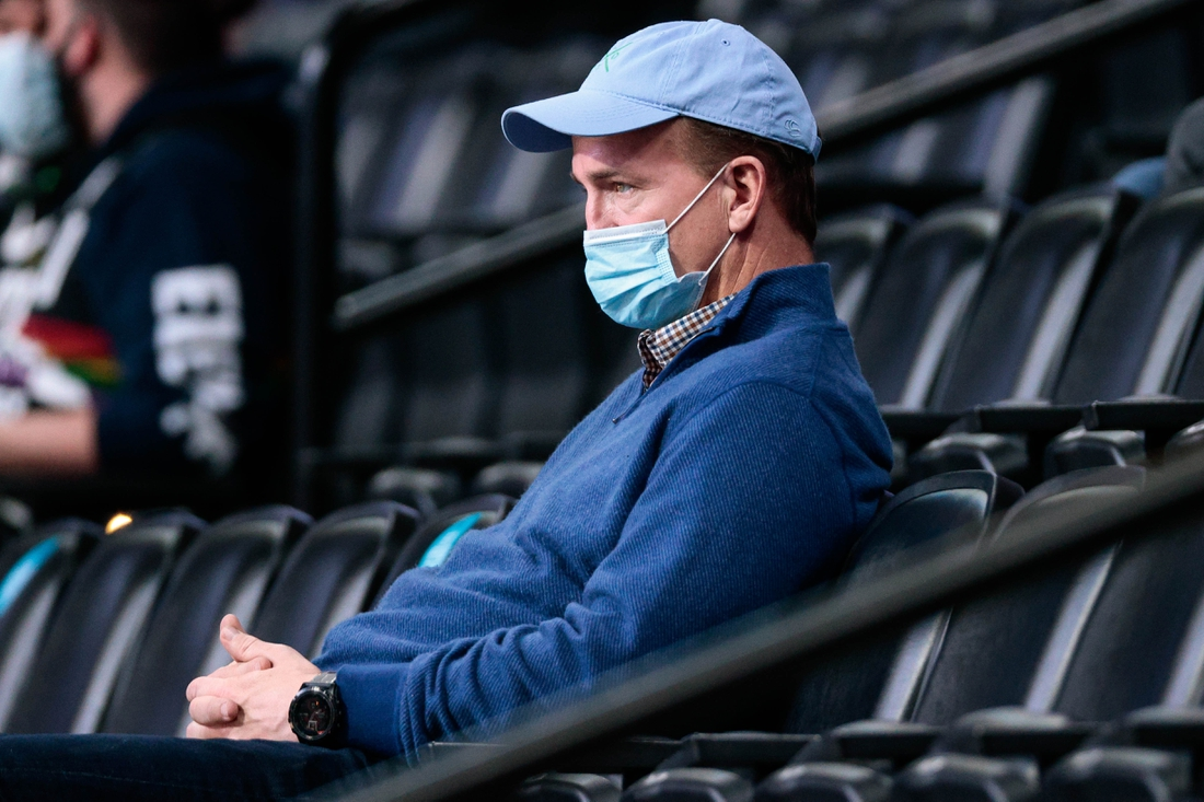 Apr 19, 2021; Denver, Colorado, USA; Former NFL player Peyton Manning watches in the second quarter of the game between the Denver Nuggets and the Memphis Grizzlies at Ball Arena. Mandatory Credit: Isaiah J. Downing-USA TODAY Sports