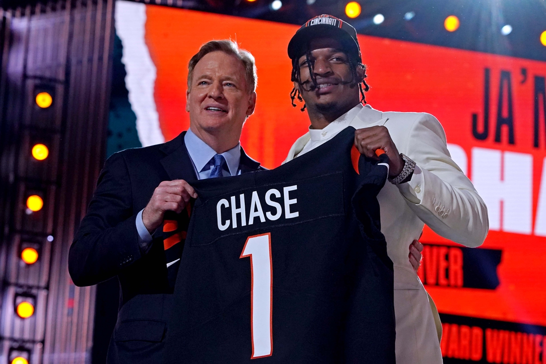 Apr 29, 2021; Cleveland, Ohio, USA; Ja'Marr Chase (LSU) with NFL commissioner Roger Goodell after being selected by Cincinnati Bengals as the number five overall pick in the first round of the 2021 NFL Draft at First Energy Stadium. Mandatory Credit: Kirby Lee-USA TODAY Sports
