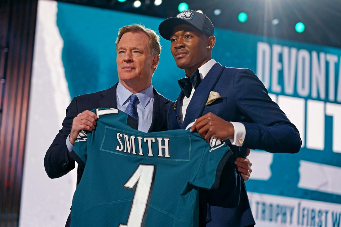 Apr 29, 2021; Cleveland, Ohio, USA; DeVonta Smith (Alabama) with NFL commissioner Roger Goodell after being selected by Philadelphia Eagles as the number ten overall pick in the first round of the 2021 NFL Draft at First Energy Stadium. Mandatory Credit: Kirby Lee-USA TODAY Sports