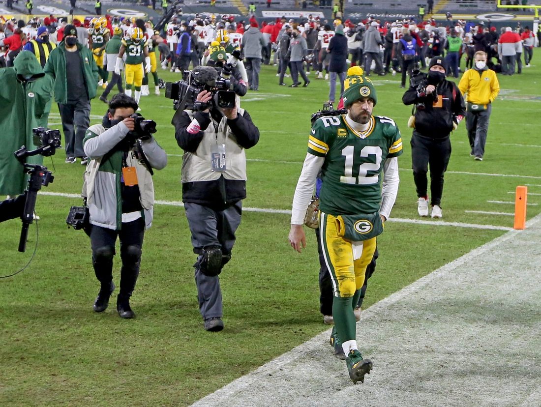 Green Bay Packers quarterback Aaron Rodgers (12) walks off the field fter the Green Bay Packers 31-26 loss to the Tampa Bay Buccaneers in the NFC Championship playoff game Sunday, Jan. 24, 2021 at Lambeau Field in Green Bay, Wis.  - Photo by Mike De Sisti / Milwaukee Journal Sentinel via USA TODAY NETWORK ORG XMIT: DBY1  Nickelcol01 P2