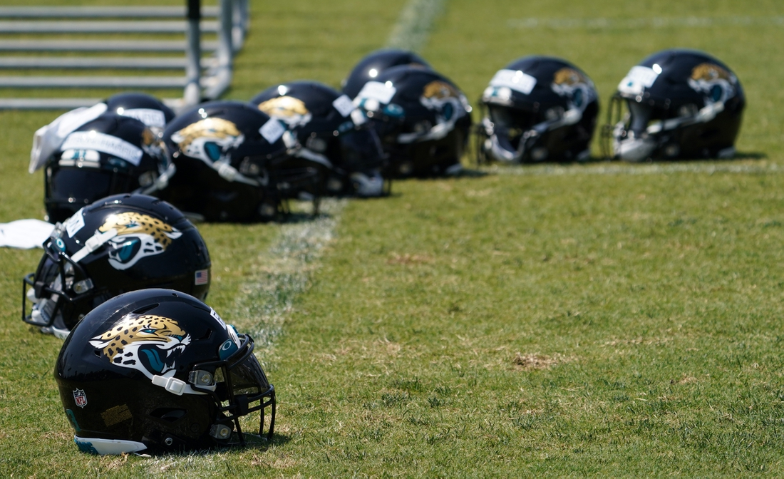 May 27, 2021; Jacksonville, Florida, USA; Jacksonville Jaguars players helmets sit pin the field during OTA at the Dream Finders Homes Practice Complex. Mandatory Credit: Jasen Vinlove-USA TODAY Sports