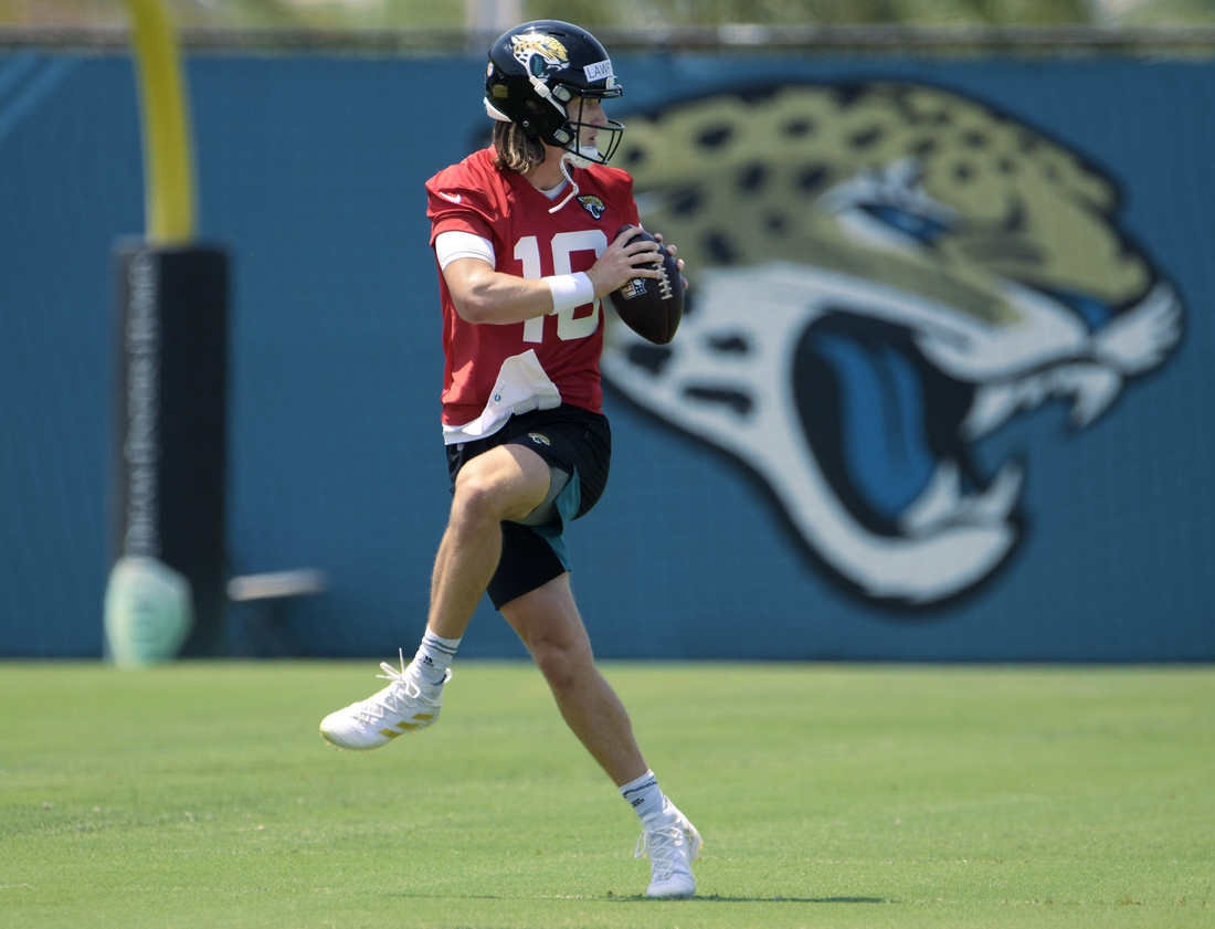 Jacksonville Jaguars (16) QB Trevor Lawrence goes through drills during Thursday's OTA session. The Jacksonville Jaguars held their Thursday session of organized team activity at the practice fields outside TIAA Bank Field, May 27, 2021.  Jki 052721 Jagsotas 09