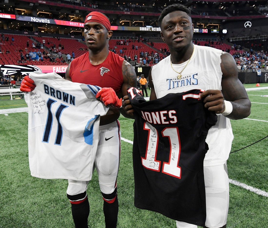 Atlanta Falcons wide receiver Julio Jones (11) and Tennessee Titans wide receiver A.J. Brown (11) exchange jerseys after the Titans' 24-10 win at Mercedes-Benz Stadium Sunday, Sept. 29, 2019 in Atlanta, Ga.
