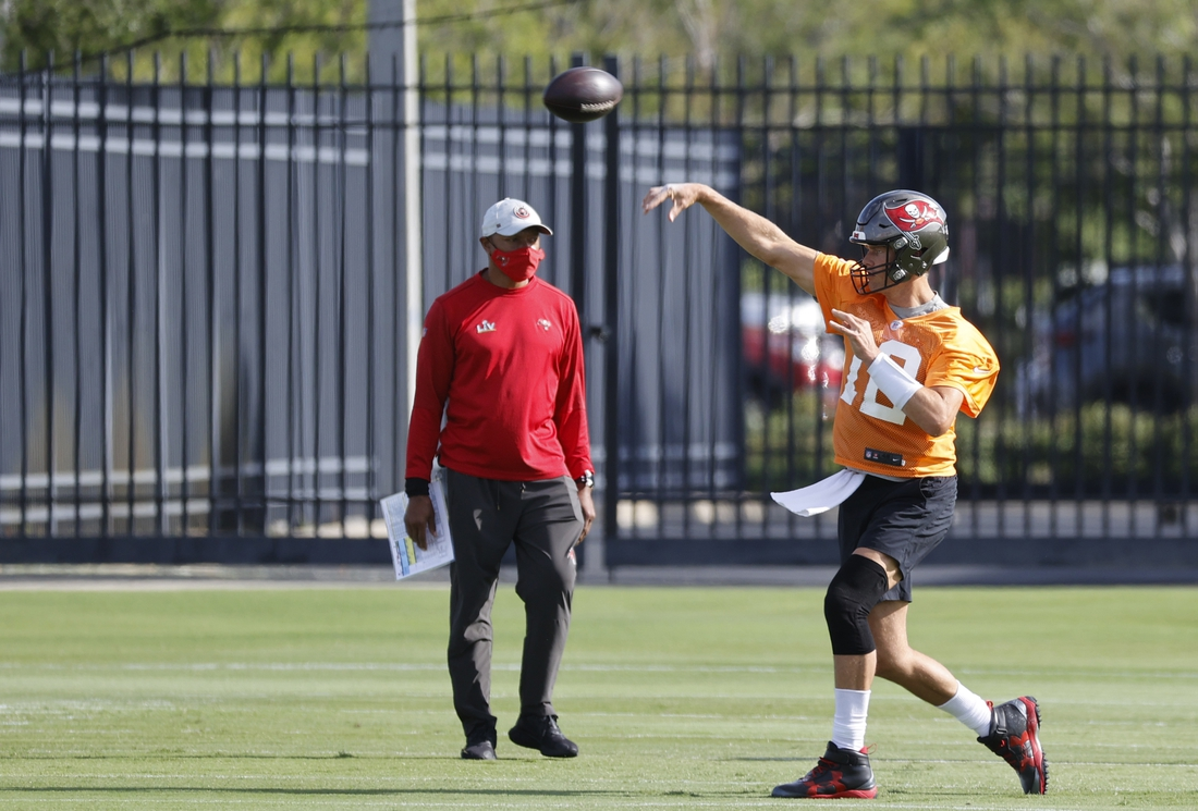 Jun 8, 2021; Tampa, FL, USA; Tampa Bay Buccaneers quarterback Tom Brady (12) works out during mini camp at AdventHealth Training Center. Mandatory Credit: Kim Klement-USA TODAY Sports