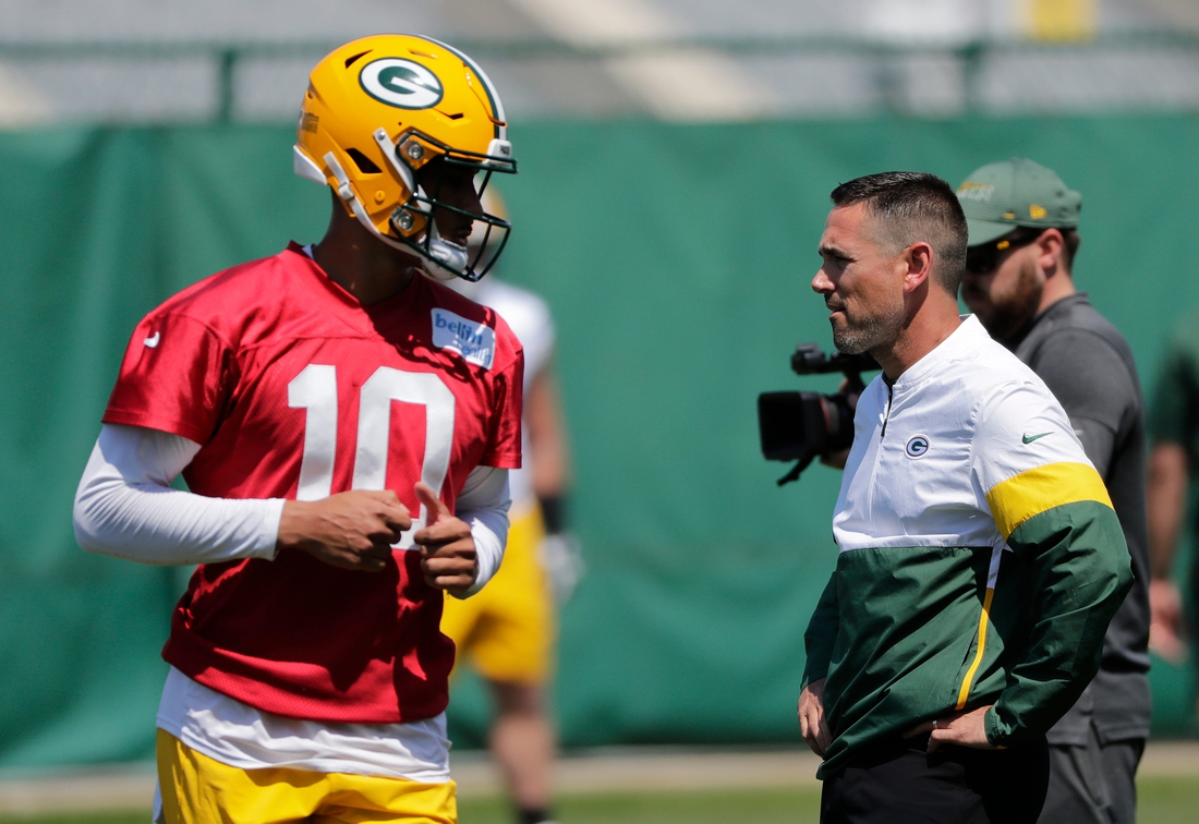 Green Bay Packers head coach Matt LaFleur engages with Jordan Love (10) as he participates in minicamp practice Wednesday, June 9, 2021, in Green Bay, Wis.  Cent02 7g5lqijkew5hy1rt71c Original
