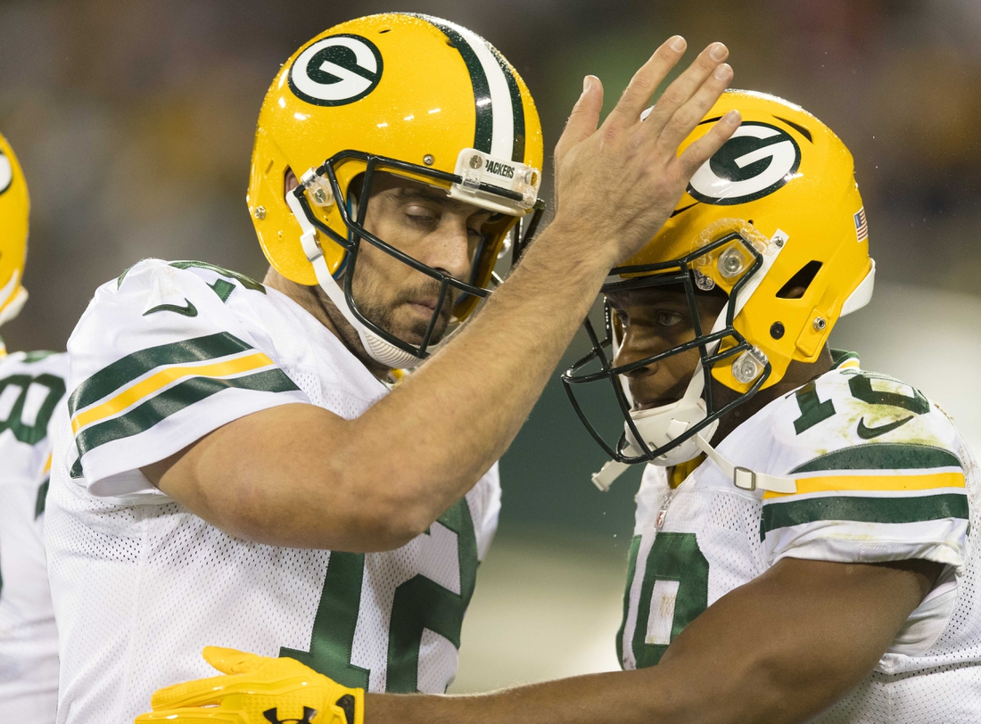 Sep 28, 2017; Green Bay, WI, USA; Green Bay Packers quarterback Aaron Rodgers (12) celebrates with wide receiver Randall Cobb (18) following a touchdown during the third quarter against the Chicago Bears at Lambeau Field. Mandatory Credit: Jeff Hanisch-USA TODAY Sports