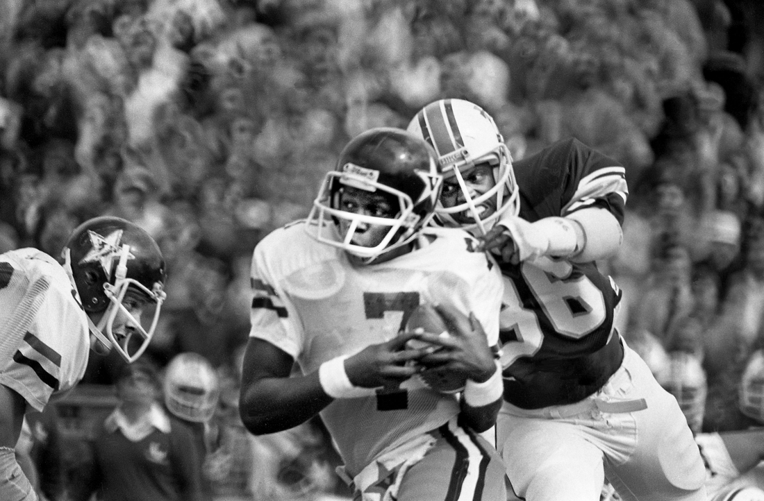 Vanderbilt quarterback Van Heflin (7) tries to escape the relentless pressure of Tulane defensive end Al Jones during the first half. The Commodores fall to the Green Waves 38-3 before a home crowd of an estimated 27,600 at Dudley Field Oct. 7, 1978.  78then10 009