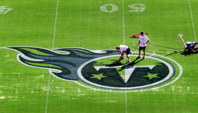 Groundkeepers paint the Tennessee Titans logo at midfield in preparation Aug. 21, 1999 at the Adelphia Coliseum in downtown Nashville for the opening game Aug. 27.  Tennessee Titans Getting Adelphia Coliseum Ready