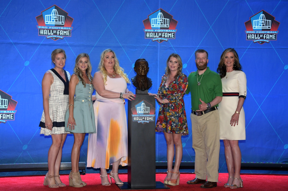 Aug 3, 2019; Canton, OH, USA; Members of the Bowlen family pose with the bust of the late Pat Bowlen during the Pro Football Hall of Fame Enshrinement at Tom Benson Hall of Fame Stadium. Mandatory Credit: Kirby Lee-USA TODAY Sports