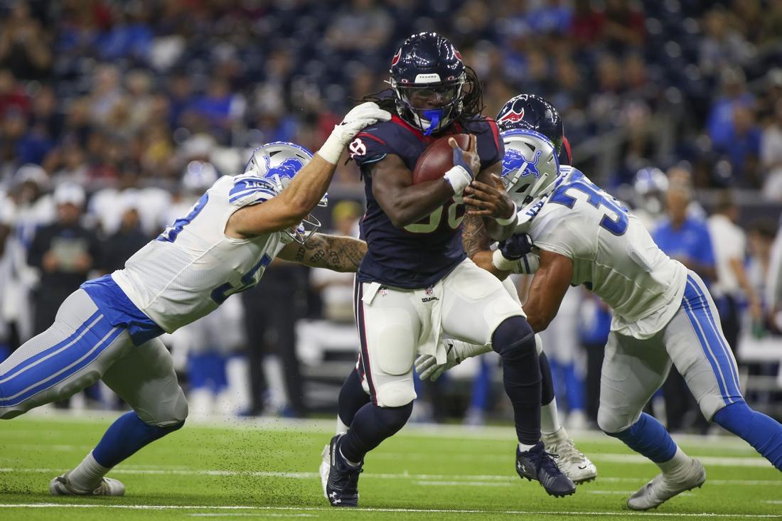 Aug 17, 2019; Houston, TX, USA; Detroit Lions linebacker Garret Dooley (58) reaches for Houston Texans running back Buddy Howell (38) during the fourth quarter at NRG Stadium. Mandatory Credit: John Glaser-USA TODAY Sports